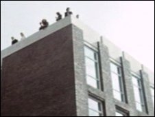 Students on roof of Liverpool University