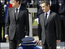 French President Nicolas Sarkozy, right, and Spanish Prime Minister Jose Luis Rodriguez Zapatero stand next to the coffin of Jean-Serge Nerin, 23 March 2010
