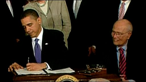 Barack Obama signs health care bill