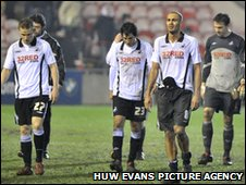 Swansea City's players trudge off after the final whistle