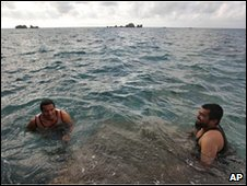 Former Guantanamo detainees Khelil Mamut (left) and Salahidin Abdulahat swim off Bermuda, June 2009