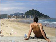 Sunbather on Spanish beach