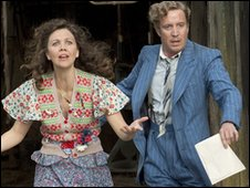 Mrs. Green (Maggie Gyllenhaal) and Phil (Rhys Ifans) run out of the barn