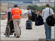 A man in a wheelchair leaving Gaza