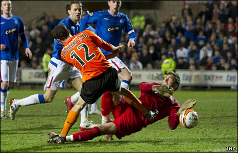 David Robertson scores a goal for Dundee United against Rangers