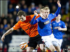 Dundee United striker Jon Daly and Rangers forward Steven Naismith