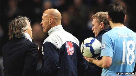 Mancini (left) and Moyes