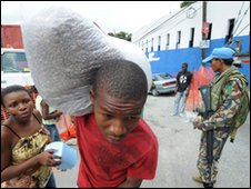 Haitians receive foreign aid in Port-au-Prince, 20 March