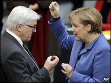 German Chancellor Angela Merkel, right, and the faction leader of the German Social Democrats, Frank-Walter Steinmeier