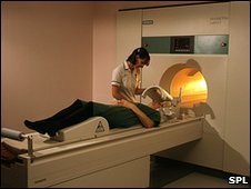 A woman patient is prepared for a MRI brain scan Scanner
