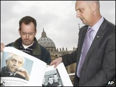 Members of the Survivors Network of those Abused by Priests show pictures of Pope Benedict and of Fr Lawrence Murphy, outside The Vatican