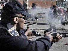 Policemen in South Africa firing rubber bullets
