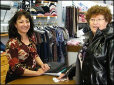 Shopkeeper Sylvie Auteau and a customer
