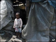 Child outside shack in Harare