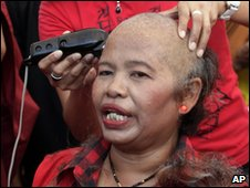 A protester has her head shaved in Bangkok on 25 March 2010
