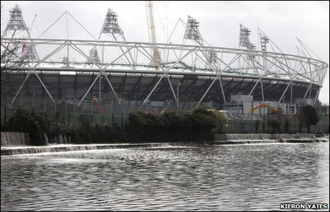 Water flooding into the Lee by the Olympic Stadium