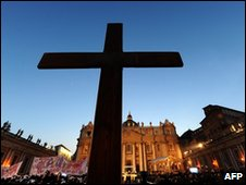 A giant cross is seen in St Peter's Square at the Vatican, 25 March