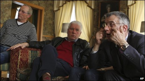 From left: Gianni Bisoli, 60, Dario Laiti, 59, and Alessandro Vantini, 60, are interviewed in a Roman hotel room, 26 March