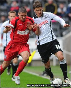 Ipswich's Jon Walters challenges Swansea's Andrea Orlandi for the ball