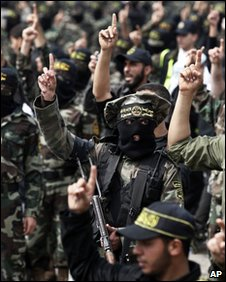 Palestinian Islamic Jihad militants rally in Gaza City, 27 March