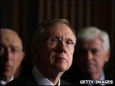 Senator Harry Reid (centre) in Washington, 25 March