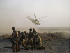 British soldiers with helicopter (Library)