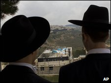 Ultra-orthodox Jewish men look at construction site in East Jerusalem