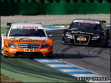 Gary Paffett leads Timo Scheider in the DTM finale last season