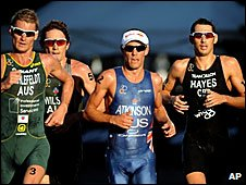 Stuart Hayes (right) competing in the Mooloolaba triathlon