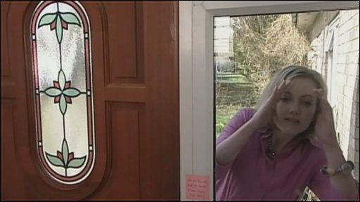 Reporter looking through  window