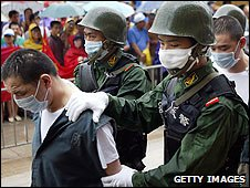 Police lead convicted drug dealers to their execution, Hangzhou, China (June 2004)
