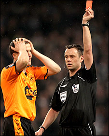 Gary Caldwell is sent off by referee Stuart Attwell