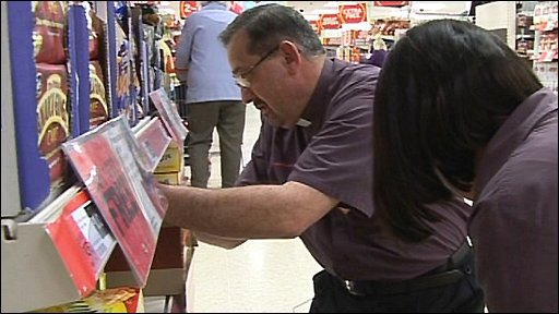 Reverend Peter Mallinson stacking shelves at the supermarket where he has worked for the past 16 years