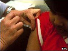 A child being immunised against meningitis