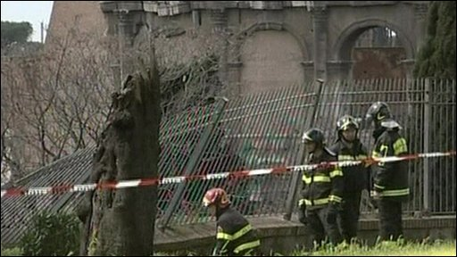 Emergency workers at the scene of the Nero Palace collapse