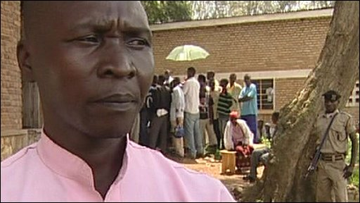 A man allowed out of prison to give evidence at a village court in Rwanda