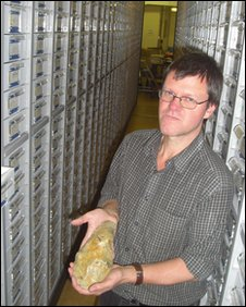 Dr Ashton with handaxe