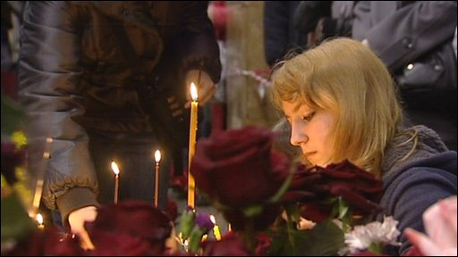 Mourners lay flowers at the scene of the Moscow Metro suicide bombings