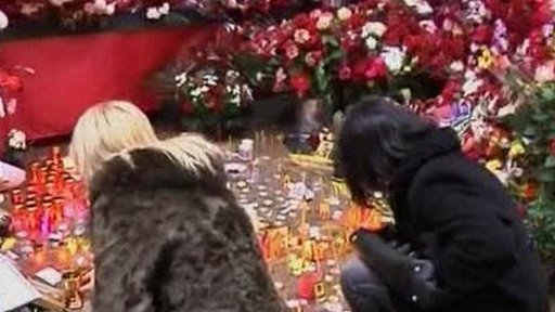 Mourners lay flowers at the scene of the Moscow Metro bombings