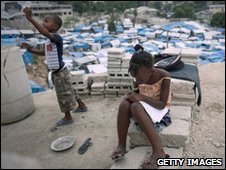 Earthquake survivors in a tent city in Port-au-Prince