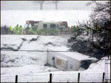 Coach on its side in the snow. Photo by Mark Attwood
