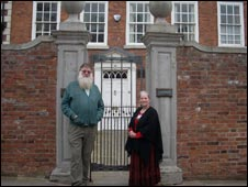 Martin Wood and Audrey Tomlin outside Scrooge's house