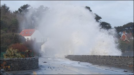 Waves breach the Guernsey sea wall at Perelle