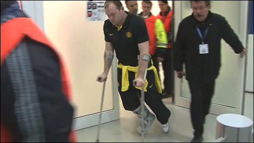 Wayne Rooney on crutches after the game with Bayern Munich