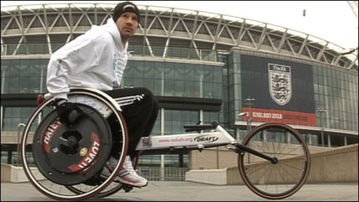 Danny Mills and the wheelchair he will compete in the Brighton Marathon