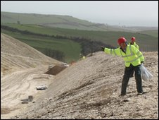 Worker sowing seed on Weymouth Relief Road Ridgeway