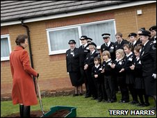 Princess Anne with spade and St John Ambulance staff and volunteers