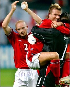 Danny Mills and David Beckham celebrate after victory over Argentina in a 2002 World Cup group match