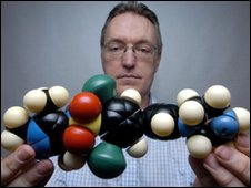Prof Paul Wyatt holds a molecular model of the new drug compound