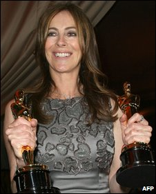 Kathryn Bigelow holding two of her Oscar awards.